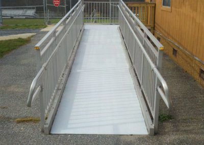 4. The maintenance personnel applied Safe Tread to the ramp surfaces and found that the Safe Tread filled the grooves and provided a safe footing for the students and teachers.